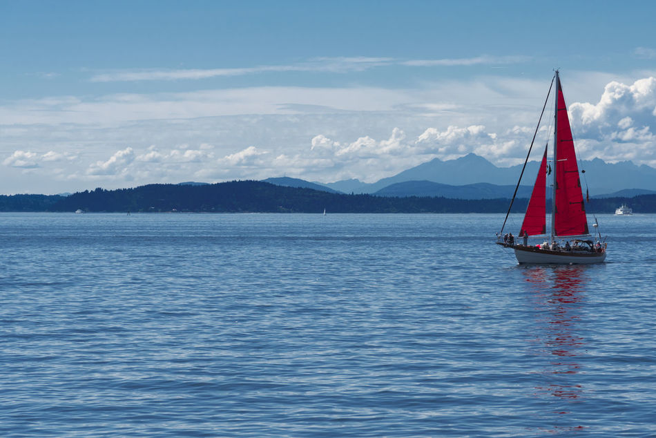 Red sails on sailboat on Puget Sound near Seattle Beauty In Nature Cloud - Sky Day Mountain Nature Nautical Vessel No People Outdoors Red Red Sailboat Sailing Scenics Sea Seattle, Washington Sky Tranquil Scene Tranquility Transportation Water Waterfront