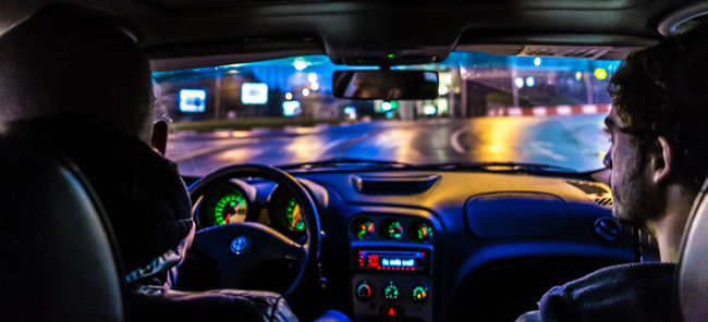 Car Interior City City Life Driving Headshot Journey Lifestyles Night Night Drive On The Move Passenger Steering Wheel Traveling Unrecognizable Person Vehicle Interior Windshield