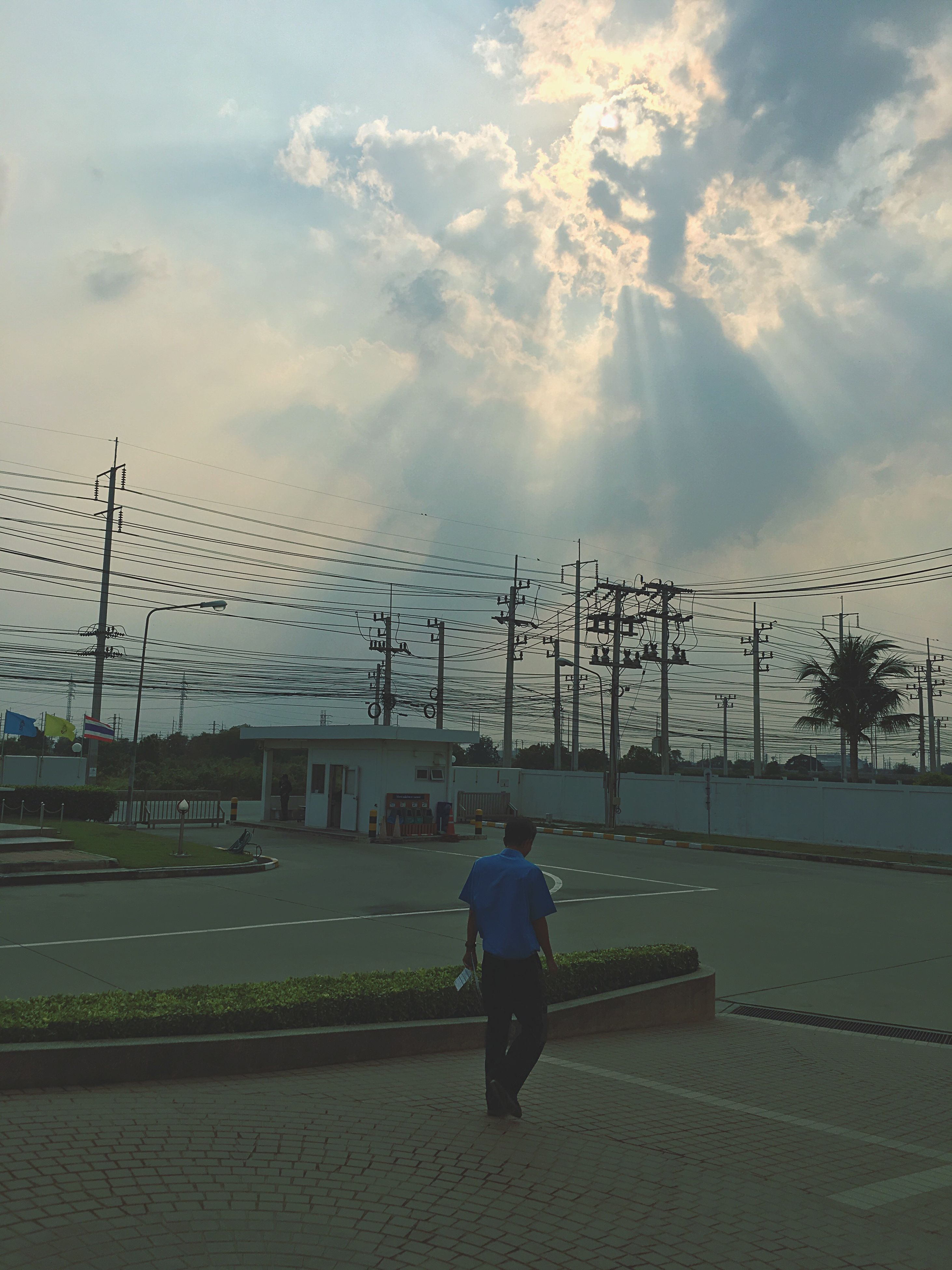 sky, full length, rear view, men, built structure, lifestyles, building exterior, architecture, transportation, leisure activity, walking, cloud - sky, railing, street, city, person, day, road