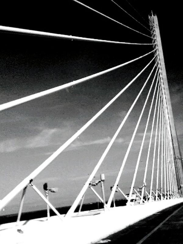Sunshine Skyway Bridge going into Pinellas County, FL. On The Road Abstract Abstract Architecture Abstractions In BlackandWhite Florida Streetphotography Bw Streetphotography Blackandwhite Darkness And Light Outdoors Driving City Life Bridge Bridge - Man Made Structure Bridgesaroundtheworld Sunshine Skyway Bridge Traveling Architecture Architectural Detail Architectural Feature Architecturelovers Lines And Angles Lines In The Sky Lines&Design Pattern Pieces
