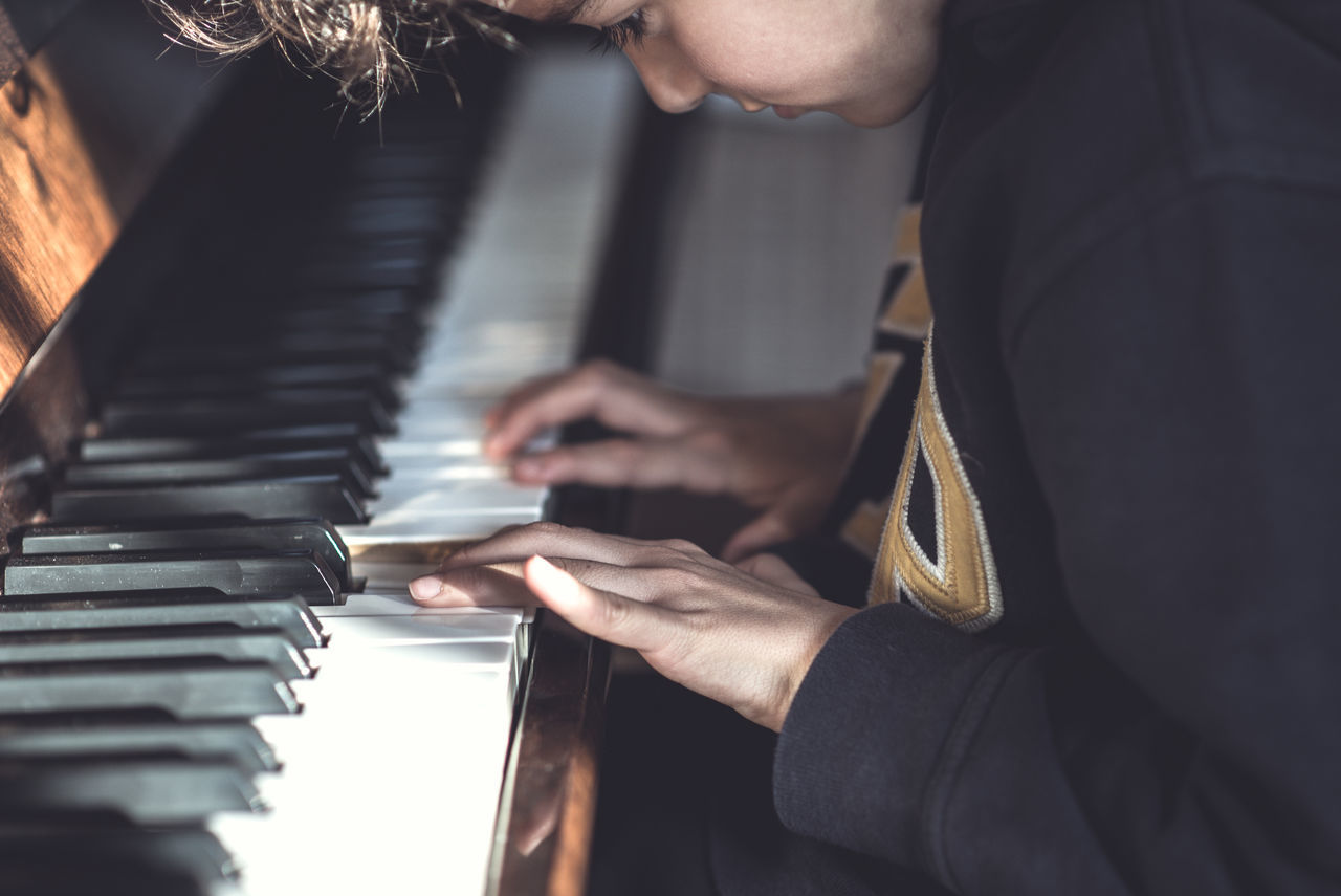 Learning to play piano arts culture and entertainment child Classical music close-up concentration day human body part human hand Learning Music musical instrument people pianist Piano piano key playing practicing Skill Student uniqueness