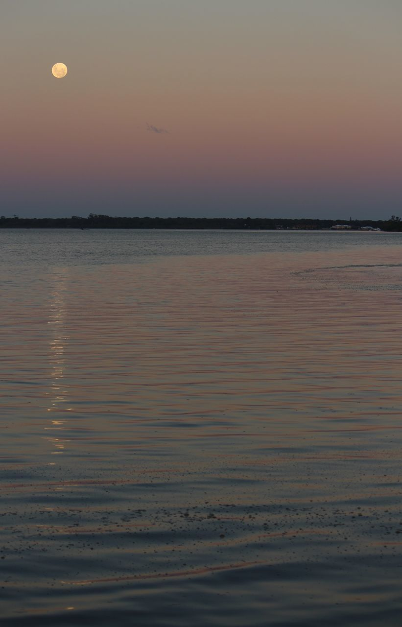sunset, beauty in nature, nature, scenics, water, sea, tranquility, tranquil scene, sky, orange color, idyllic, beach, outdoors, no people, sun, reflection, moon, horizon over water, silhouette, clear sky, day