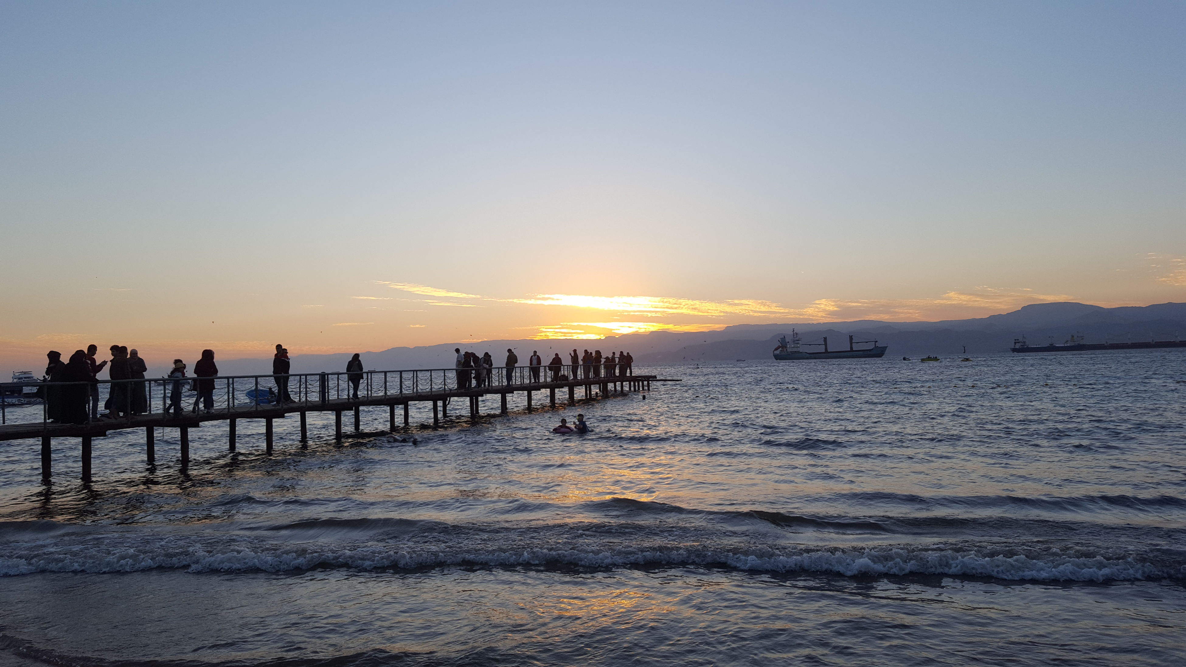 sunset, large group of people, sea, beach, sky, outdoors, nature, scenics, people, horizon over water, men, only men, water, adult, beauty in nature, adults only, day