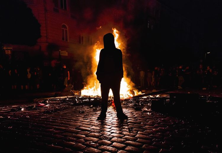- WELCOME TO G20 - G20 Gipfel G20 Hamburg G20 Summit NOG20 Black Bloc Night Rear View Real People Full Length Silhouette Standing Smoke - Physical Structure One Person Burning Built Structure Outdoors Rote Flora Schanzenviertel Schulterblatt Check This Out Autonomous G20