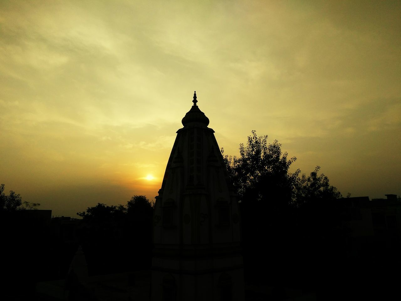 sunset, sky, religion, architecture, tree, silhouette, spirituality, built structure, no people, building exterior, place of worship, cloud - sky, outdoors, beauty in nature, nature, day