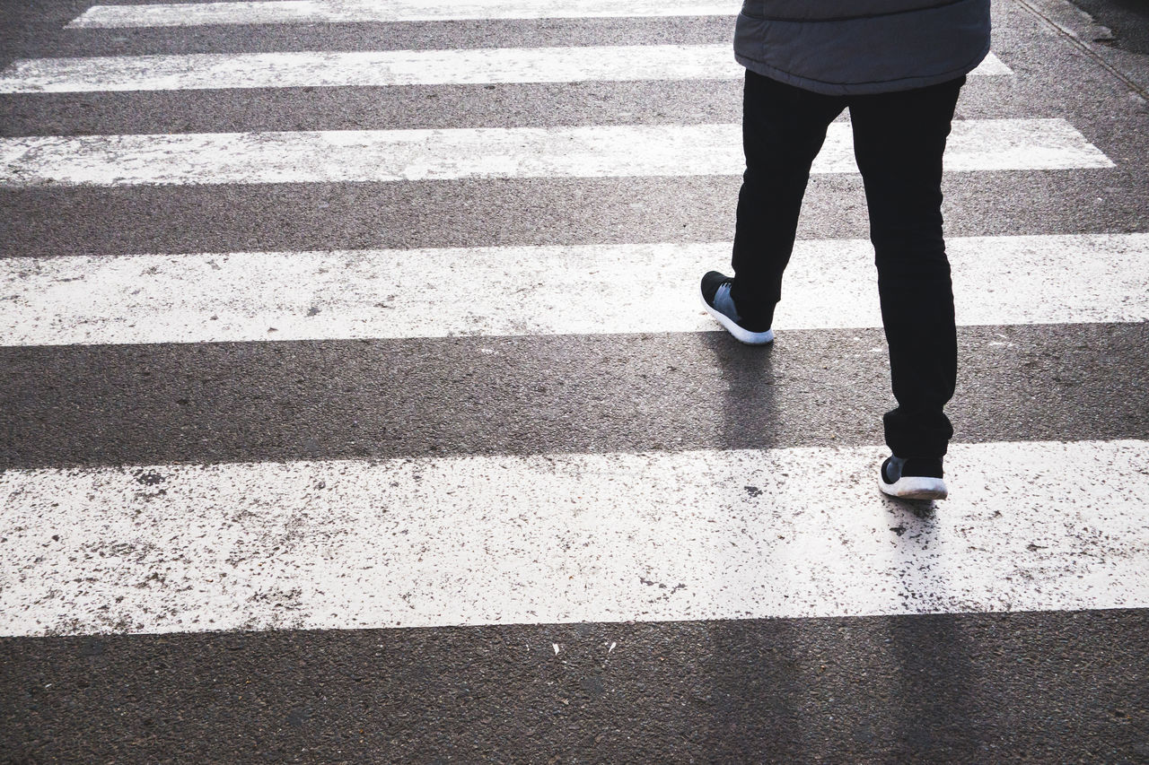 Crossing The Street Low Angle View Morocco Pedestrian Crossing Pedestrian Walkway Adult Asphalt City Crossing Day Human Leg Lifestyles Low Section One Person Outdoors Pedestrian People Real People Road Road Marking Standing Street Walking Women Zebra Crossing