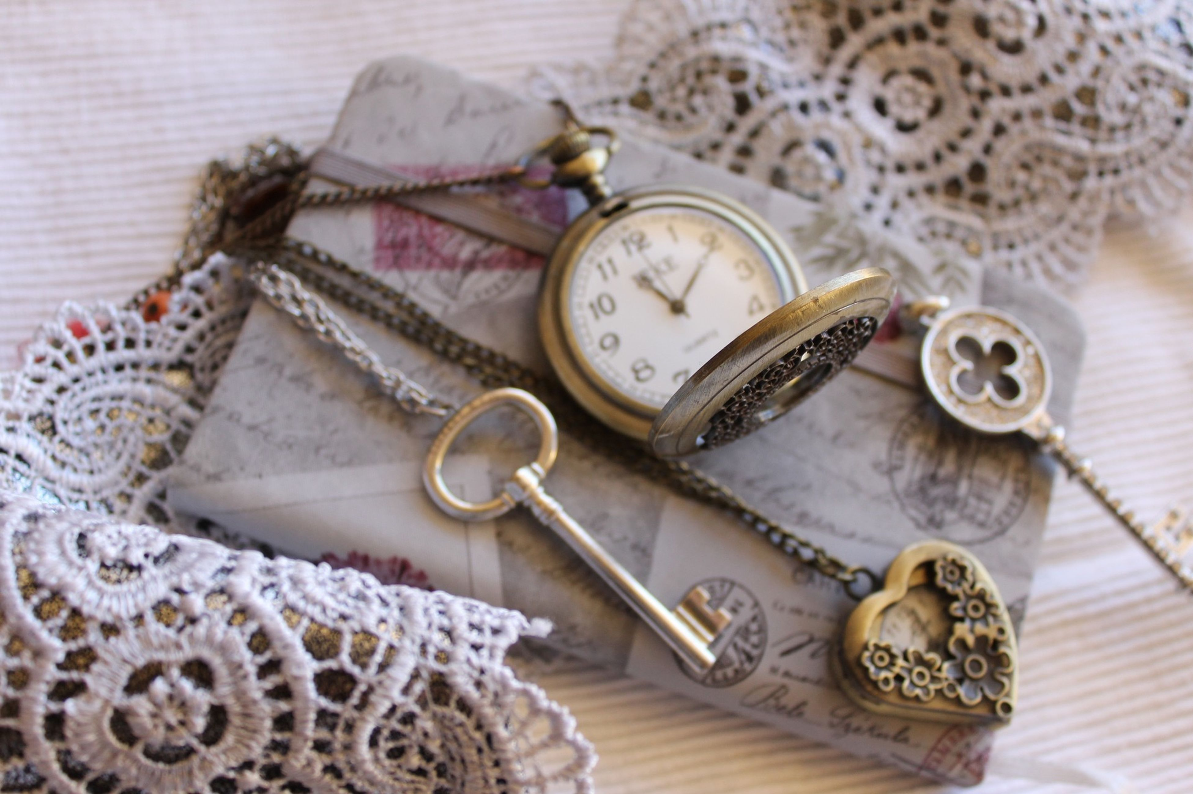 indoors, close-up, table, still life, old-fashioned, art and craft, antique, time, metal, art, high angle view, creativity, retro styled, no people, text, ornate, number, design, clock, old