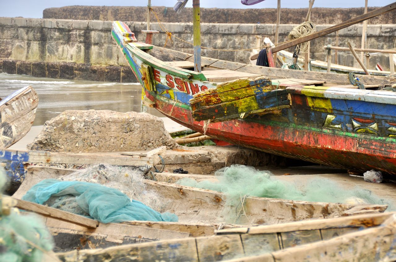 Traditional Pirogues in Ghana Accra Africa African Beach Boat Canoe Developing Country Fishing Fishing Boat Fishing Net Fishing Village Ghana Harbour Moored Nautical Vessel Outdoors Picturesque Pirogue Pirogues Rope Scenic View Sea Tradition Traditional Tranquil Scene