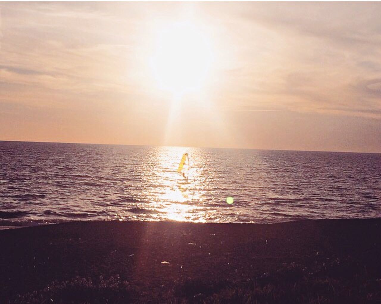 Day Sunlight Sea Sun Sunset Nature Horizon Over Water Water Real People Sunbeam Two People Sky Scenics Outdoors Beauty In Nature Beach People Reflection Reflections Sunset_collection Sunset Silhouettes Windsurfing Air Feeling Thankful Rome Italy