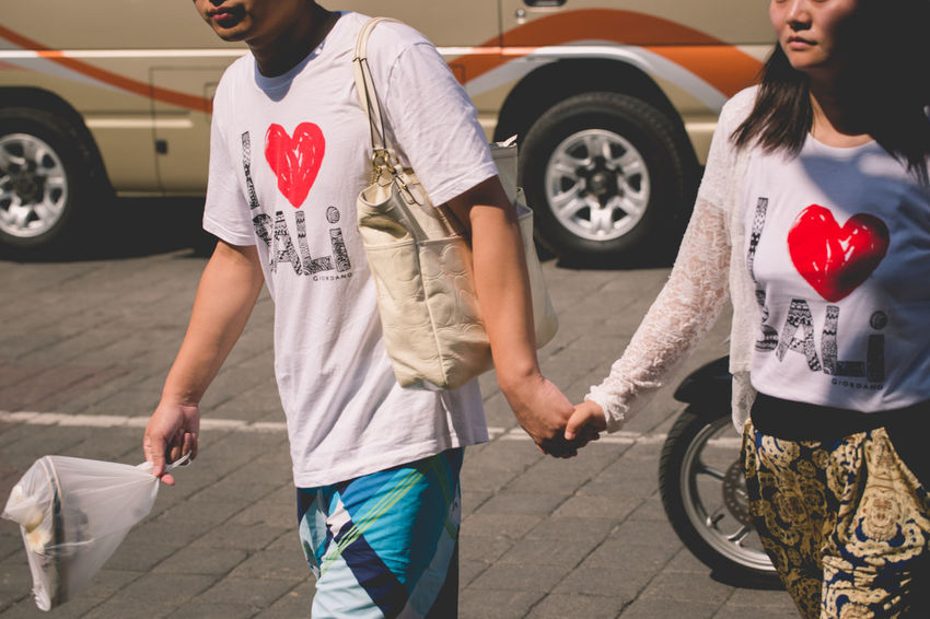 """Matching """"I love Bali"""" shirts Casual Clothing Day Holding Hands I Love BALI Leisure Activity Lifestyles Love Outdoors Tourists Walking Together"""