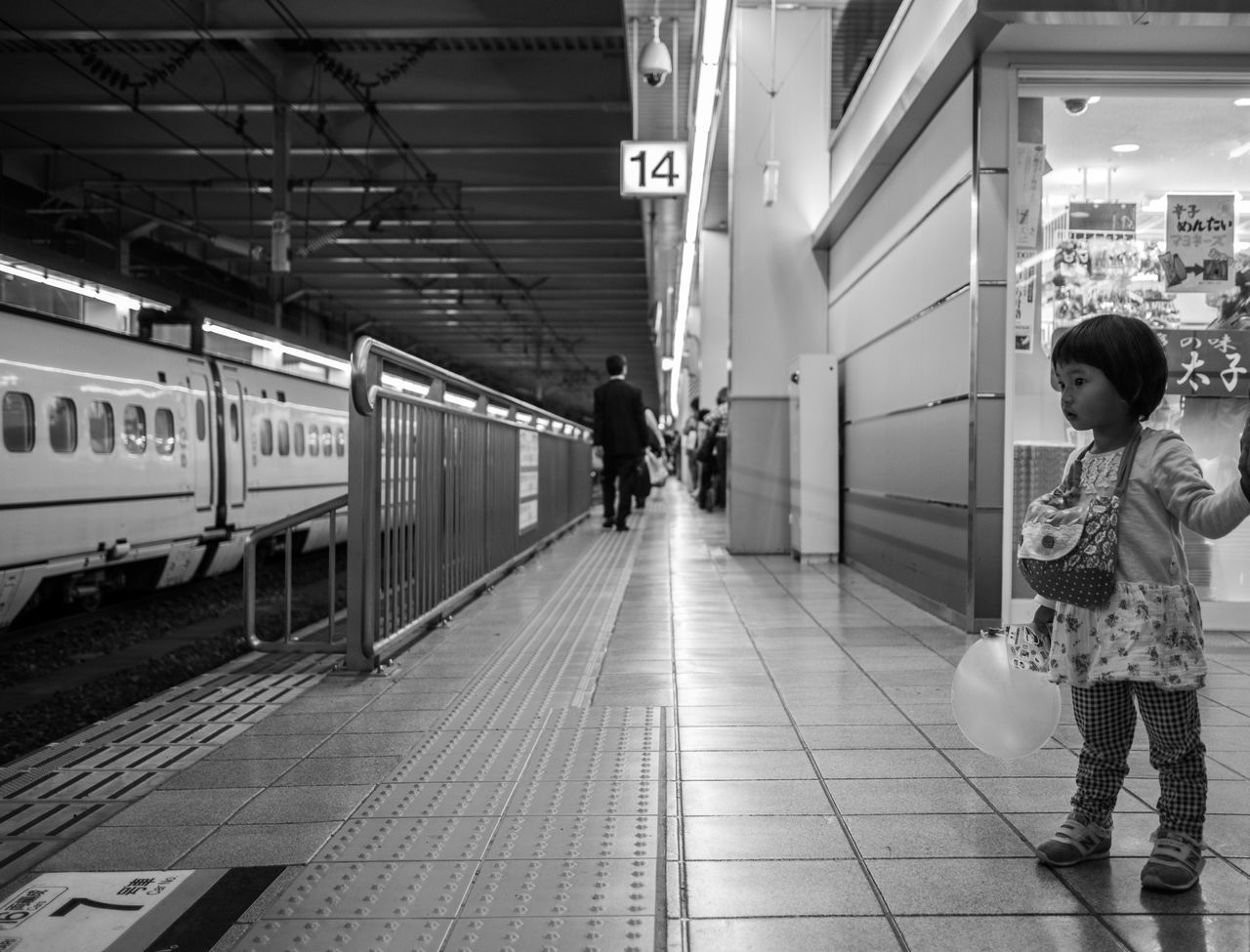 real people, transportation, full length, lifestyles, public transportation, railroad station platform, railroad station, casual clothing, childhood, rail transportation, indoors, standing, leisure activity, two people, men, illuminated, day, people