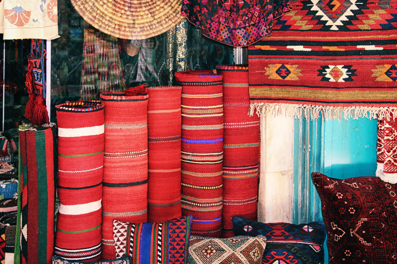 Carpet Shop Abundance Backgrounds Carpets CARPETS VENDOR Choice Colorful Colorful, Color, Design, Cultures Day Design Full Frame Geometric Shapes In A Row Jerusalem, Israel, Palestine, Middle East, Religious, Arab, Jew, Israeli, Palestinian Large Group Of Objects Market Multi Colored No People Old City, Bazaar, Market Place, Shops, Shopping, Stores, Red Repetition Retail  Store Textile Variation