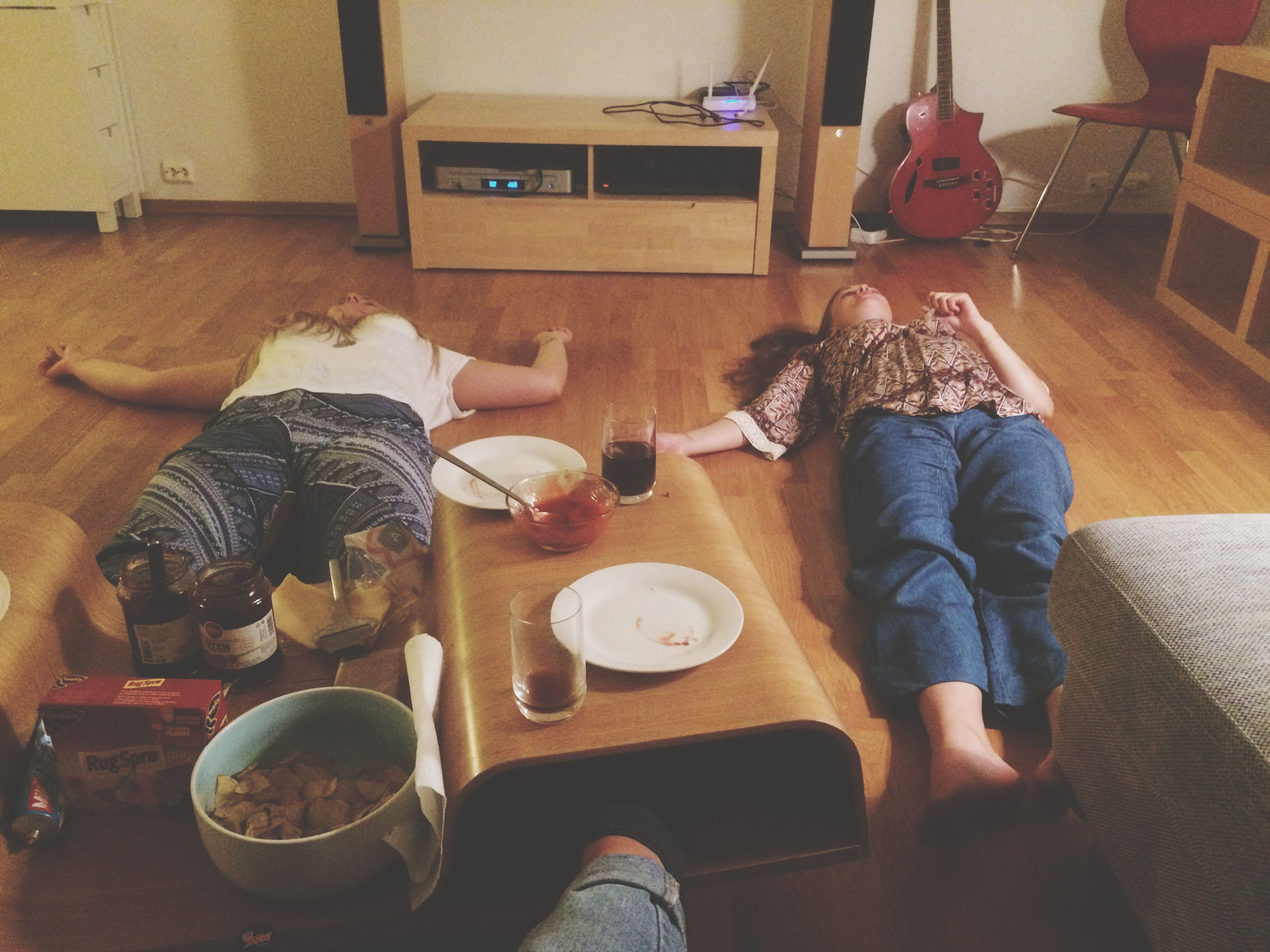 indoors, table, food and drink, lifestyles, home interior, sitting, leisure activity, casual clothing, food, high angle view, holding, domestic life, chair, coffee cup, men, wood - material, drink, relaxation
