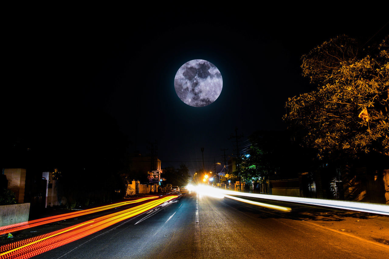 Astronomy City Dark Driving Full Moon Illuminated Long Exposure Moon Motion Night No People Outdoors Road Sky Star - Space Transportation Tree