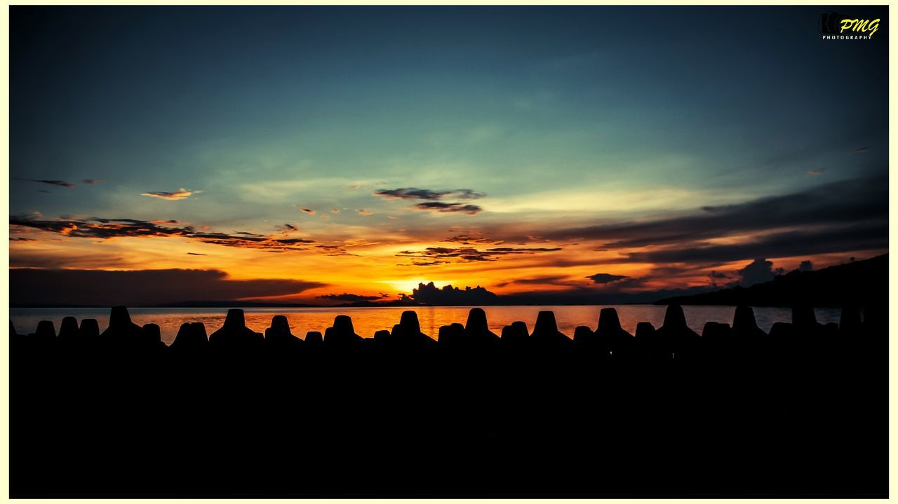 silhouette, sunset, beauty in nature, sky, scenics, sea, nature, tranquil scene, tranquility, idyllic, beach, cloud - sky, horizon over water, water, outdoors, panoramic, no people, day