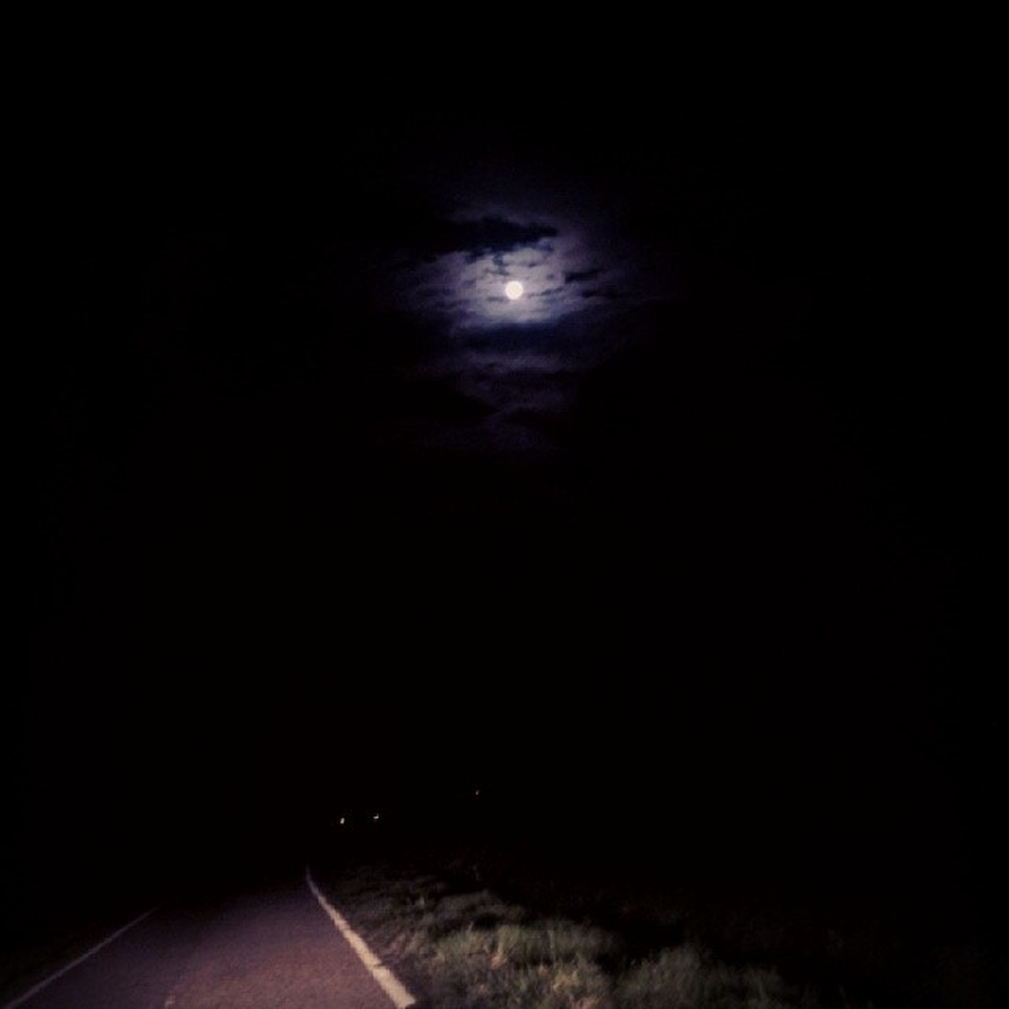 night, dark, sky, the way forward, copy space, road, transportation, tranquility, illuminated, diminishing perspective, nature, silhouette, no people, vanishing point, tranquil scene, scenics, road marking, outdoors, dusk, beauty in nature