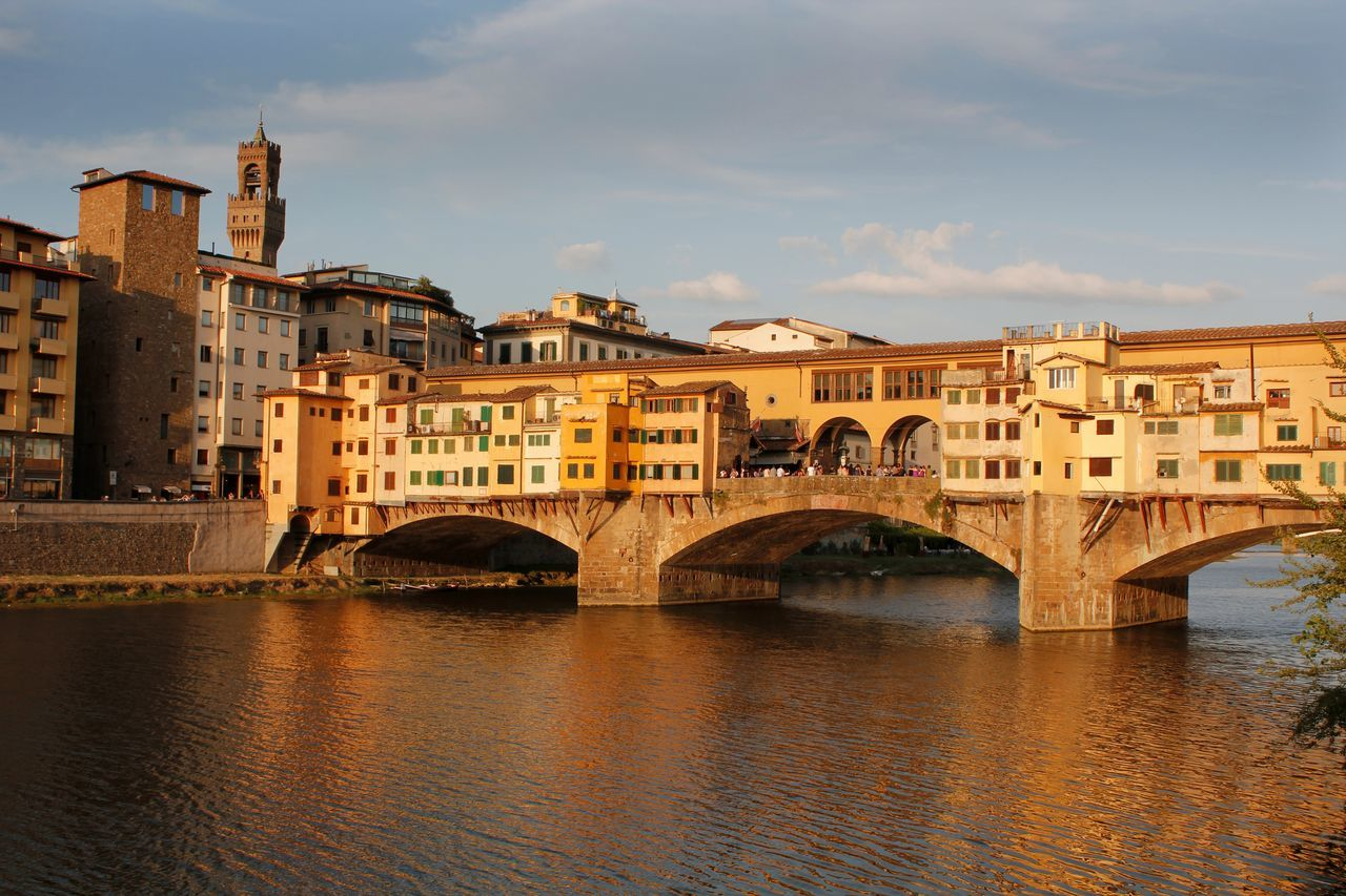 Late afternoon sunshine across the Ponte Vecchio in Florence Italy on the River Arno Architecture Bridge Bridge - Man Made Structure Building Exterior Built Structure City Connection Day Florence Italy Historical Building Italy No People Old Bridge Outdoors Ponte Vecchio Ponte Vecchio Firenze River River Arno Sky Tourist Attraction  Tourist Destination Travel Destinations Water Waterfront