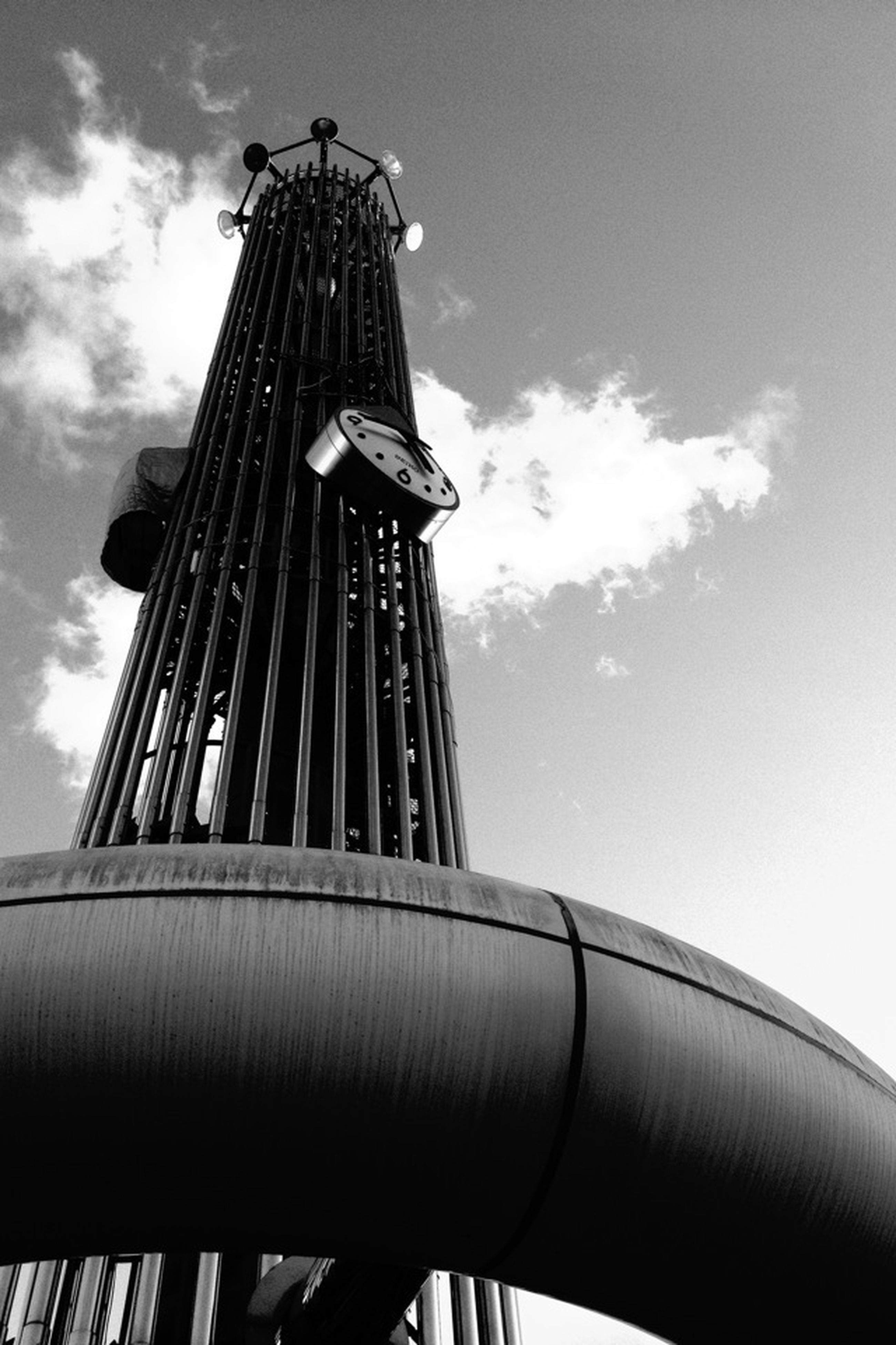 low angle view, architecture, sky, built structure, building exterior, cloud - sky, cloud, tower, tall - high, cloudy, day, no people, outdoors, metal, metallic, building, architectural feature, tall, high section, sunlight