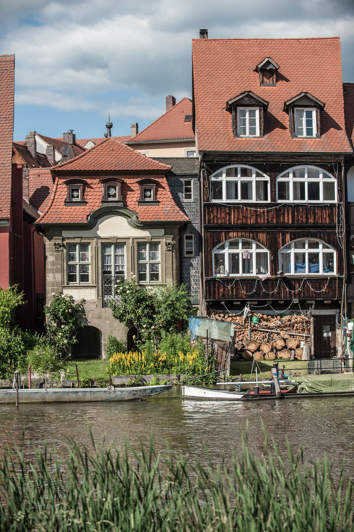 Architecture Building Exterior Built Structure City City Life Cloud - Sky Day Façade House Human Settlement Medieval No People Outdoors Residential Building Residential District Residential Structure River River Regnitz Sky South Germany Town Water Waterfront Window