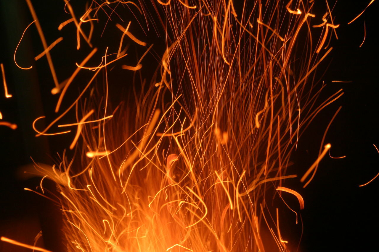 Abstract Black Background Burning Close-up Fire Flame Glowing Heat - Temperature Illuminated Lava Long Exposure Motion Nature Night No People Orange Color Outdoors Sparks Sparks Fly Sparks Flying Vibrant Color