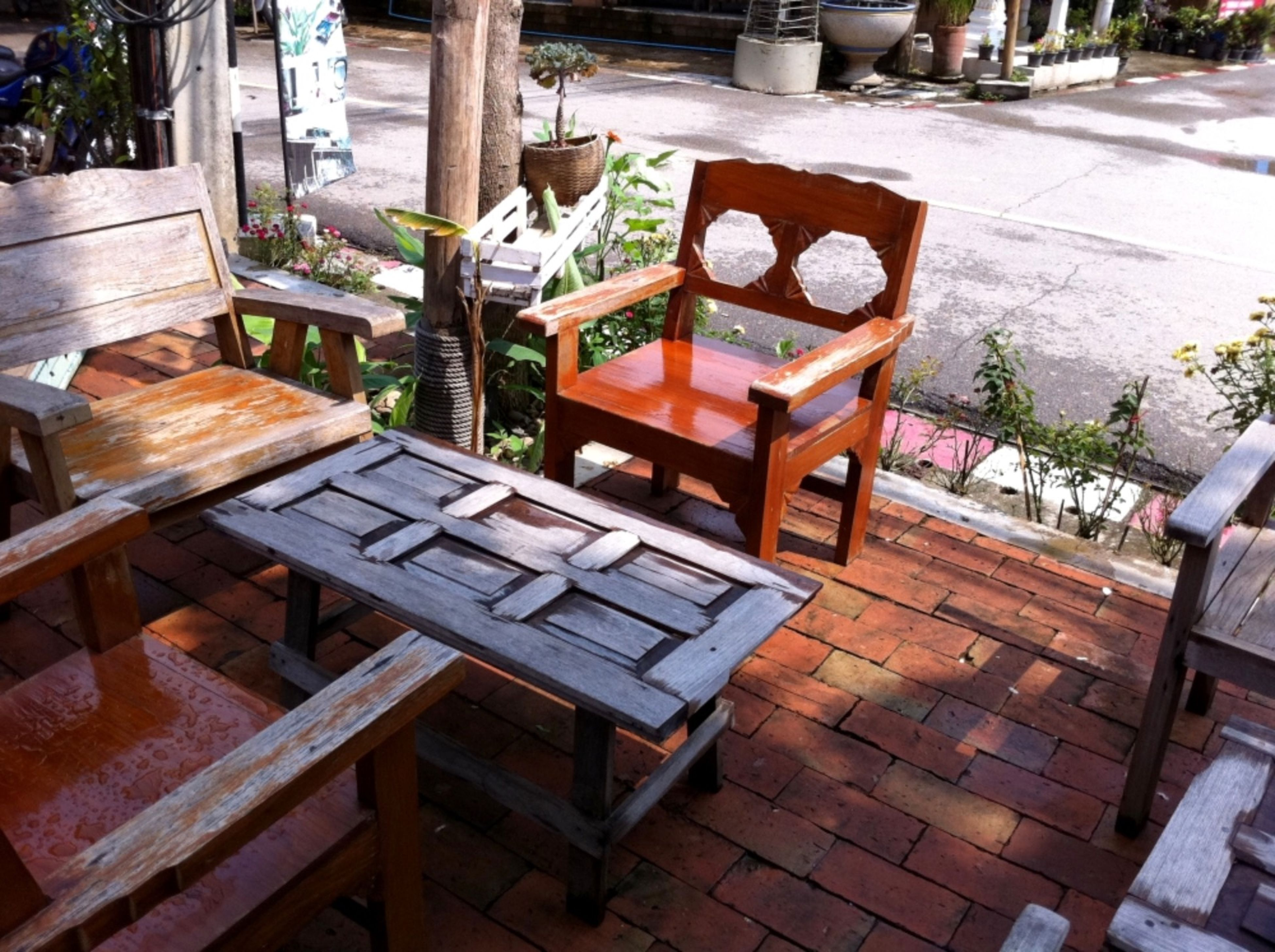 chair, wood - material, table, bench, empty, absence, wooden, seat, sunlight, day, no people, outdoors, furniture, high angle view, front or back yard, tree, wood, sidewalk, potted plant, paving stone