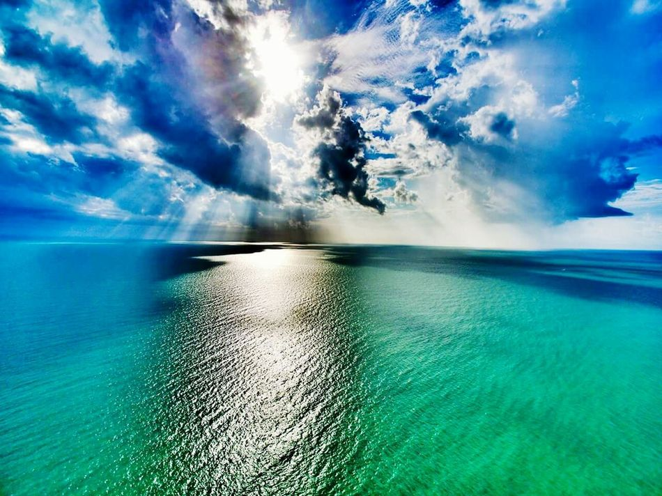 Storm clouds on a sunny day. Spring 2016 Spring In Florida April Showers April Showcase Blue Water Blue Sky Anna Maria Island Florida Life Love My Life  Beach Photography Beach Life Rays Of Sunshine Top Of The Lifeguard Stand Green Water