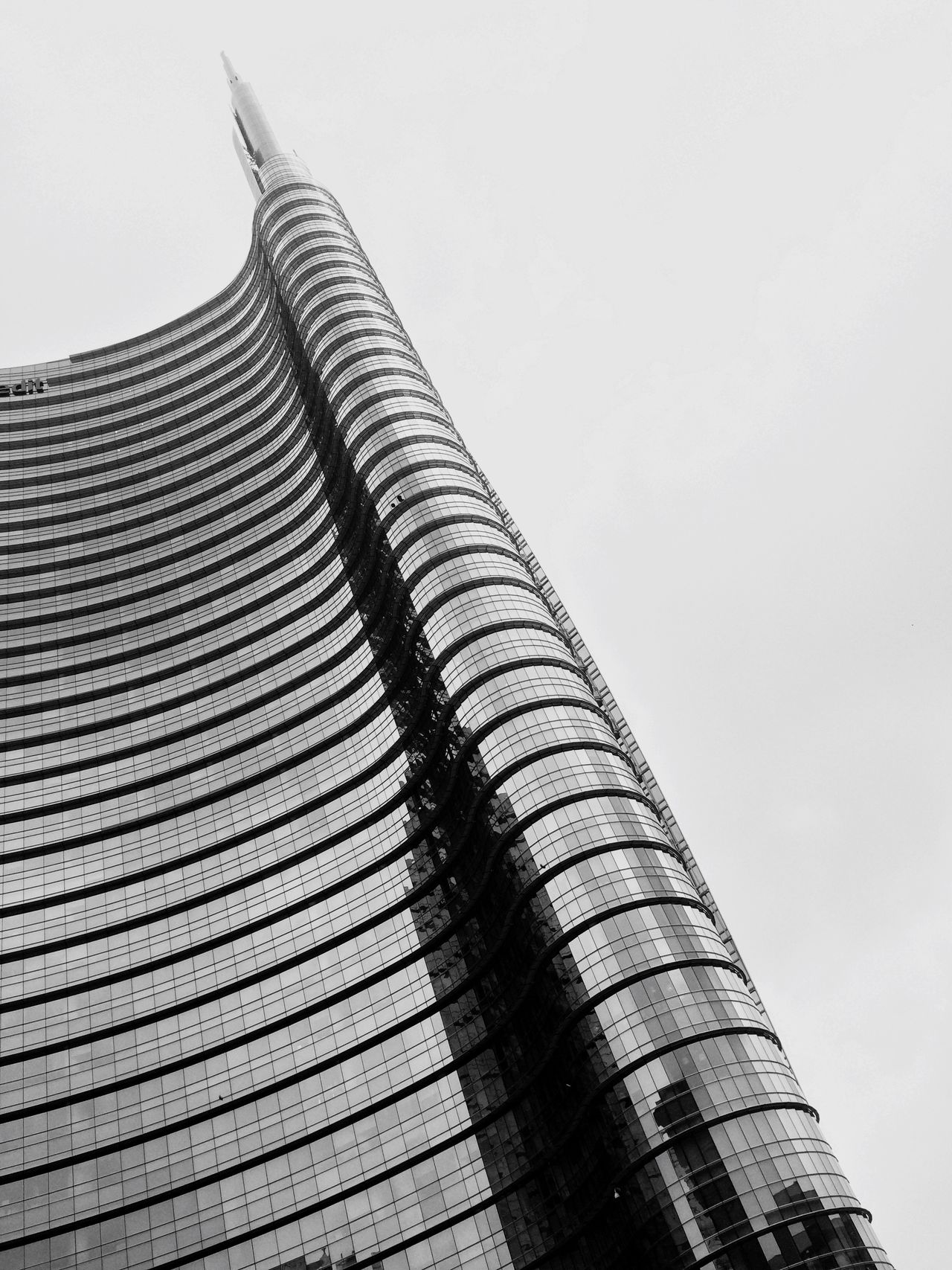 Architecture Built Structure Low Angle View Building Exterior Travel Destinations Sky No People Day Outdoors Modern Clear Sky City Blackandwhite Black & White Blackandwhite Photography Black&white Black And White Black And White Photography Milano Milan Unicredit Tower Porta Nuova Glass Windows Reflection