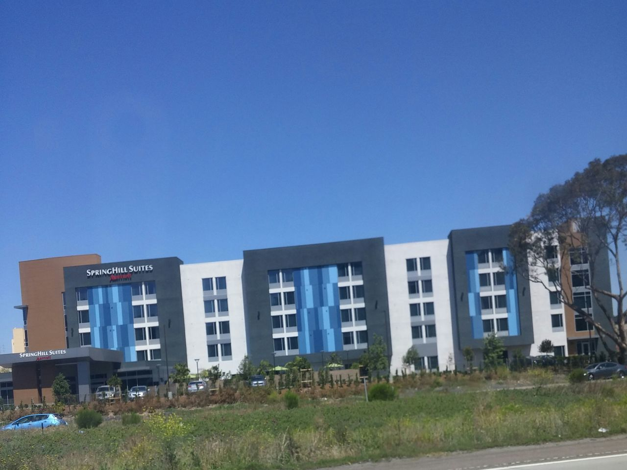 blue, architecture, clear sky, copy space, building exterior, day, no people, built structure, outdoors, grass, tree, sky