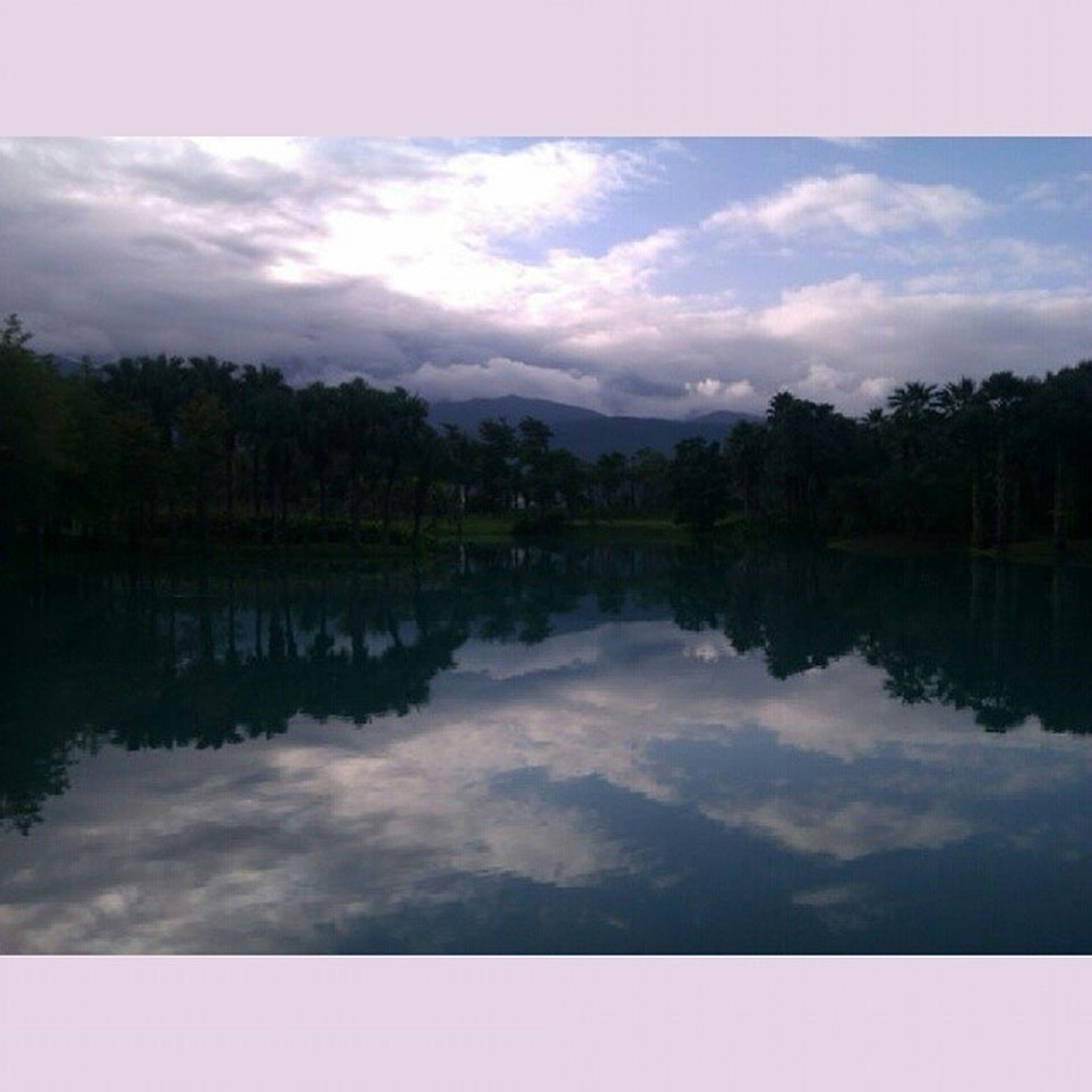 reflection, sky, lake, tranquil scene, water, tranquility, scenics, cloud - sky, tree, beauty in nature, cloud, nature, waterfront, cloudy, standing water, idyllic, calm, symmetry, outdoors, non-urban scene