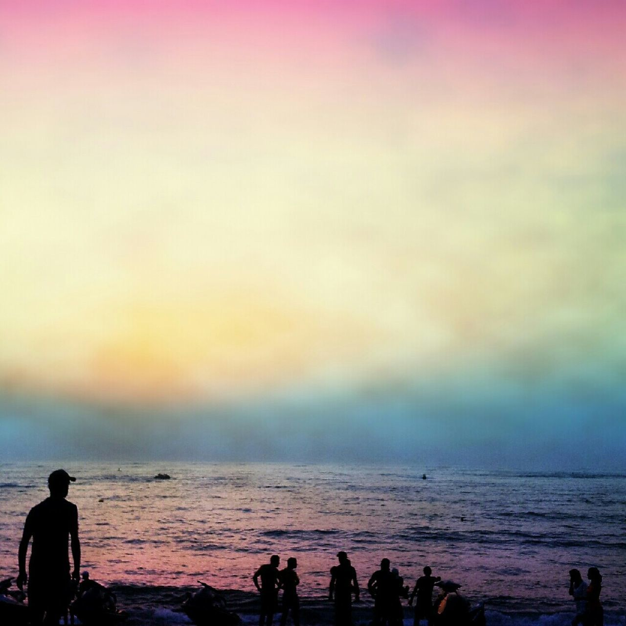 sea, sunset, real people, silhouette, water, leisure activity, beach, beauty in nature, horizon over water, nature, sky, scenics, vacations, lifestyles, outdoors, men, women, weekend activities, tranquil scene, wave, togetherness, large group of people, day, adult, people