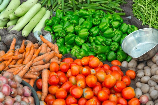 Vegetable Vendor. Food Large Group Of Objects Freshness Food And Drink Vegetable Carrot For Sale Healthy Eating Market Green Color Bell Pepper Variation Abundance Choice Market Stall Retail Display High Angle View Business Farmer Market Red Bell Pepper Colors And Patterns