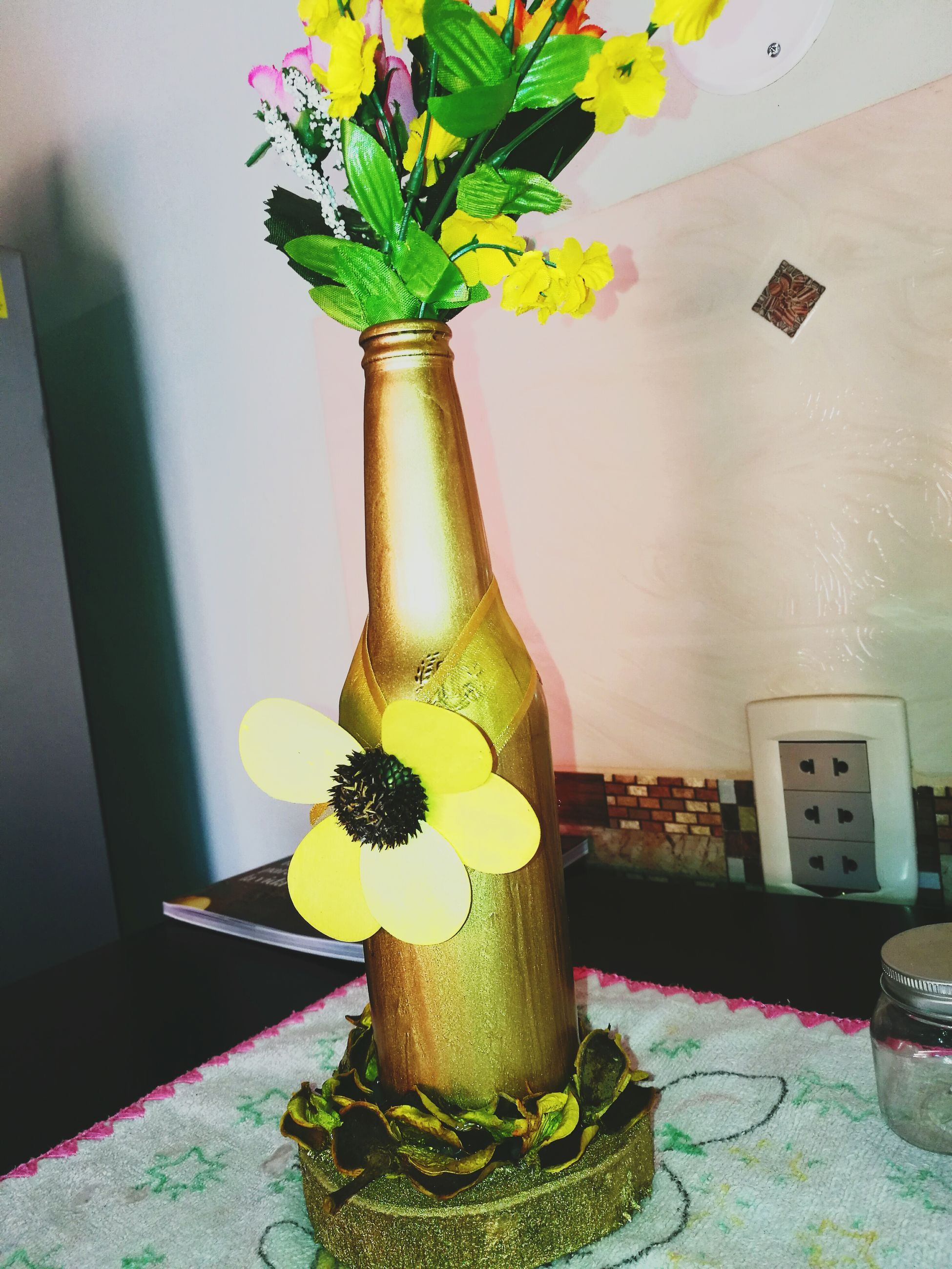flower, indoors, vase, potted plant, plant, growth, flower pot, still life, houseplant, variation, shelf, bouquet, flower arrangement, decoration, group of objects, watering can, bunch of flowers, arrangement, freshness, pot plant, house plant, large group of objects, fragility