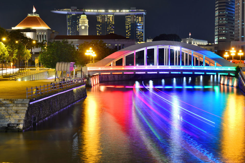Elgin Bridge at night with lighting by the Singapore River Architecture Building Exterior Built Structure Canal City City Life Elgin Bridge Glowing Illuminated Lighting Equipment Multi Colored Night Nightphotography No People Outdoors Reflection River Singapore Sky Travel Destinations Water Waterfront