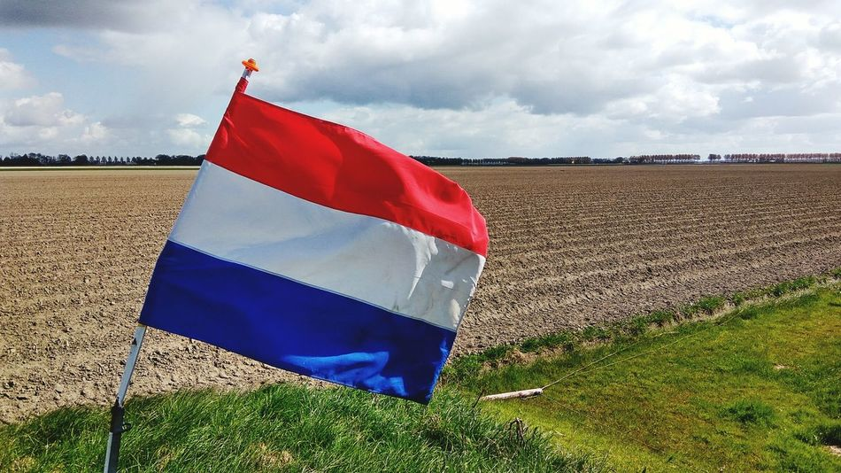 Dutch flag in agricultural landscape Flag Cloud - Sky Day Sky Red Close-up No People Nature Outdoors Flag In The Wind Dutch Dutch Countyside Waving Flag