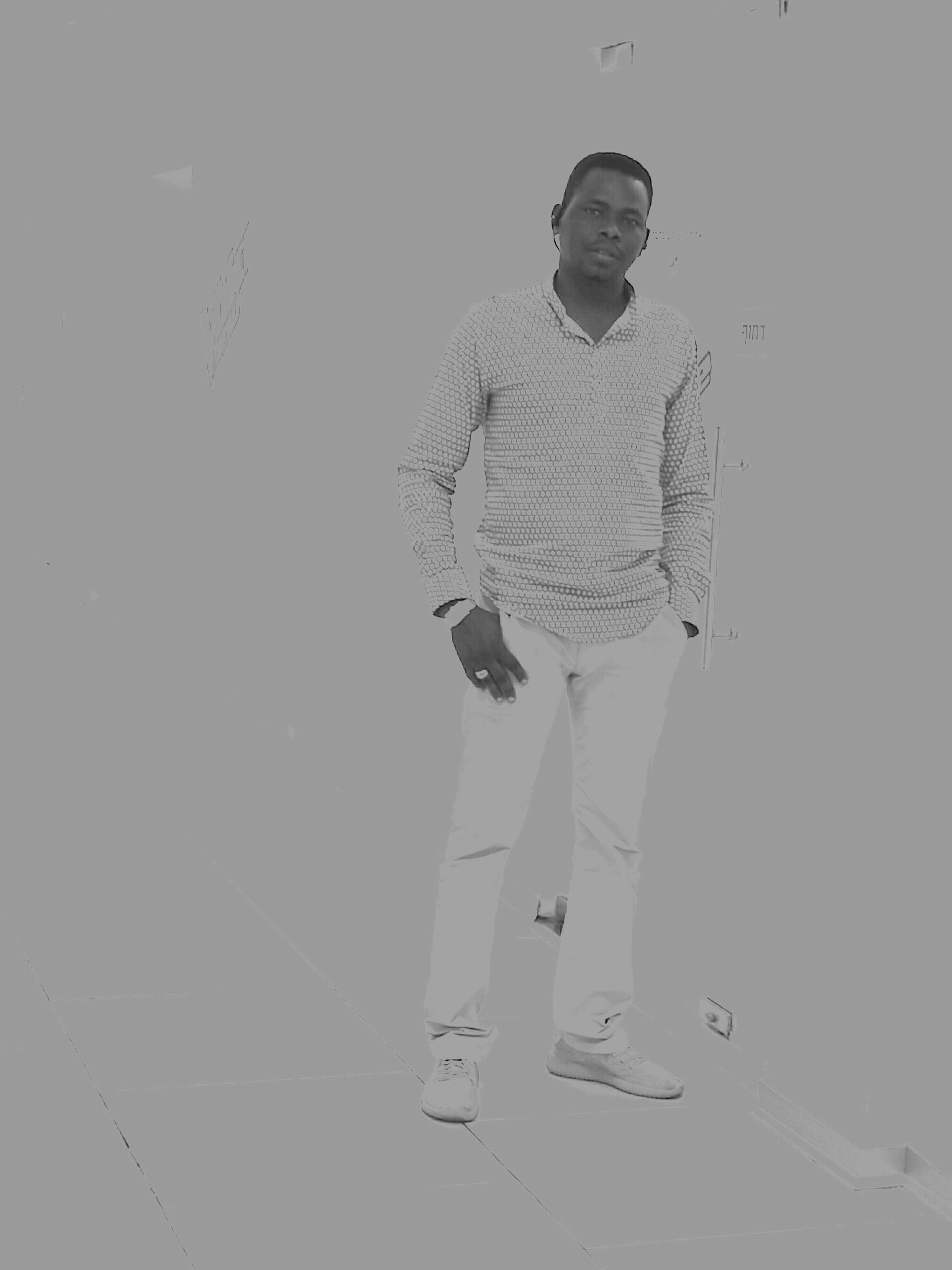 standing, person, sunglasses, young adult, hands in pockets, casual clothing, looking at camera, front view, confidence, fashionable, studio shot, attitude