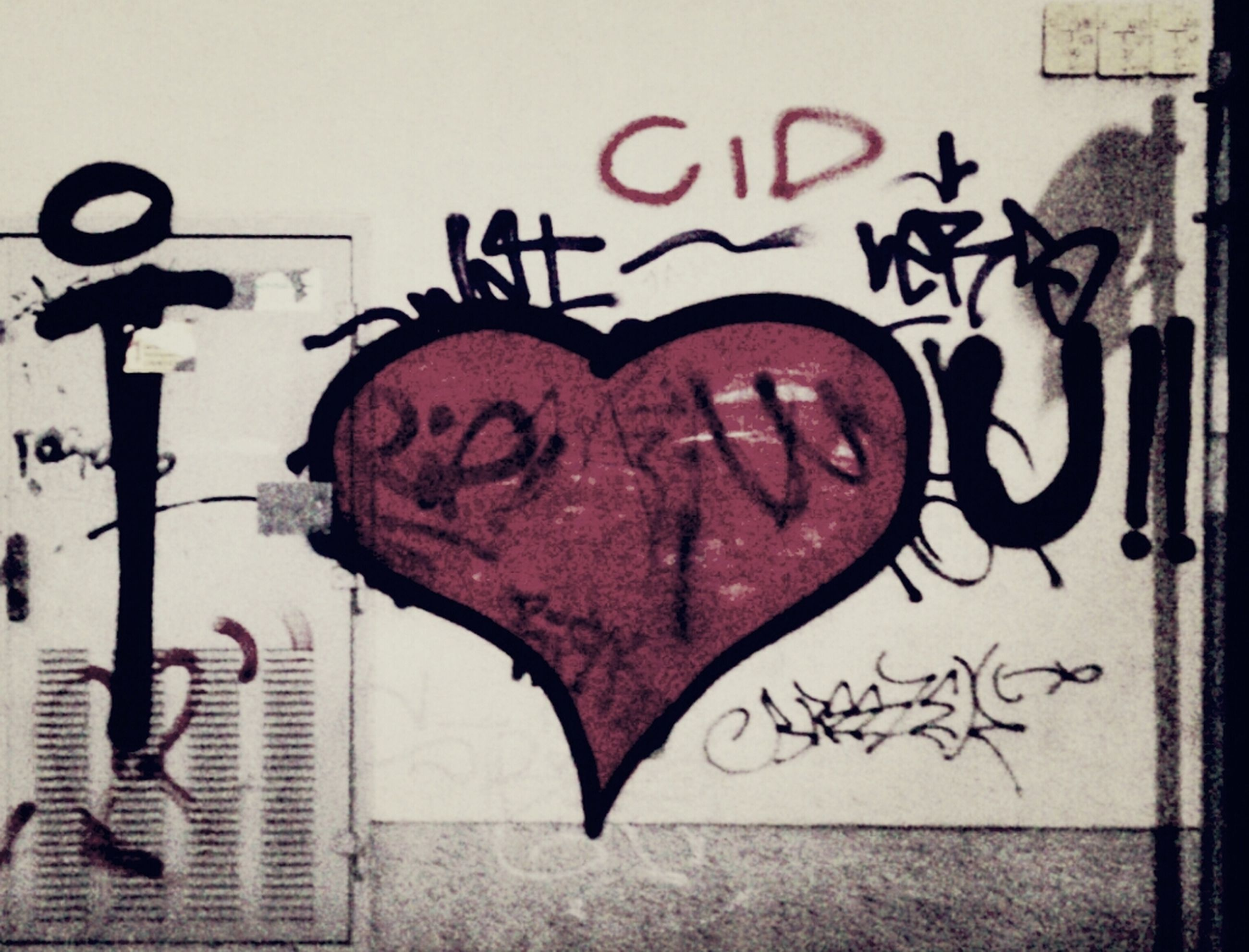 text, western script, communication, creativity, art and craft, art, wall - building feature, graffiti, capital letter, red, close-up, human representation, love, heart shape, built structure, architecture, animal representation, wall, message, sign