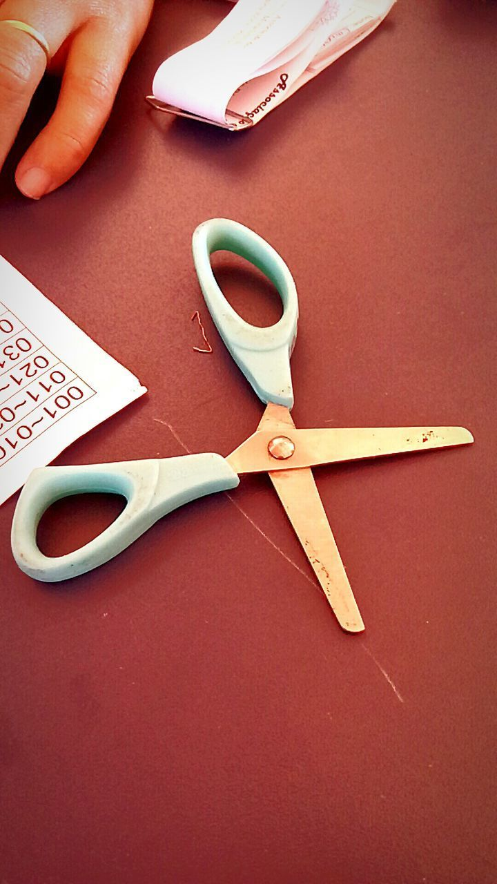 scissors, cutting, human hand, human body part, high angle view, indoors, table, paper, one person, real people, lifestyles, close-up, day, people