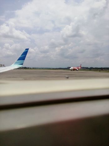 From An Airplane Window Last-minute Flight Going To An Exotic Place Airport Boarding Catching A Flight