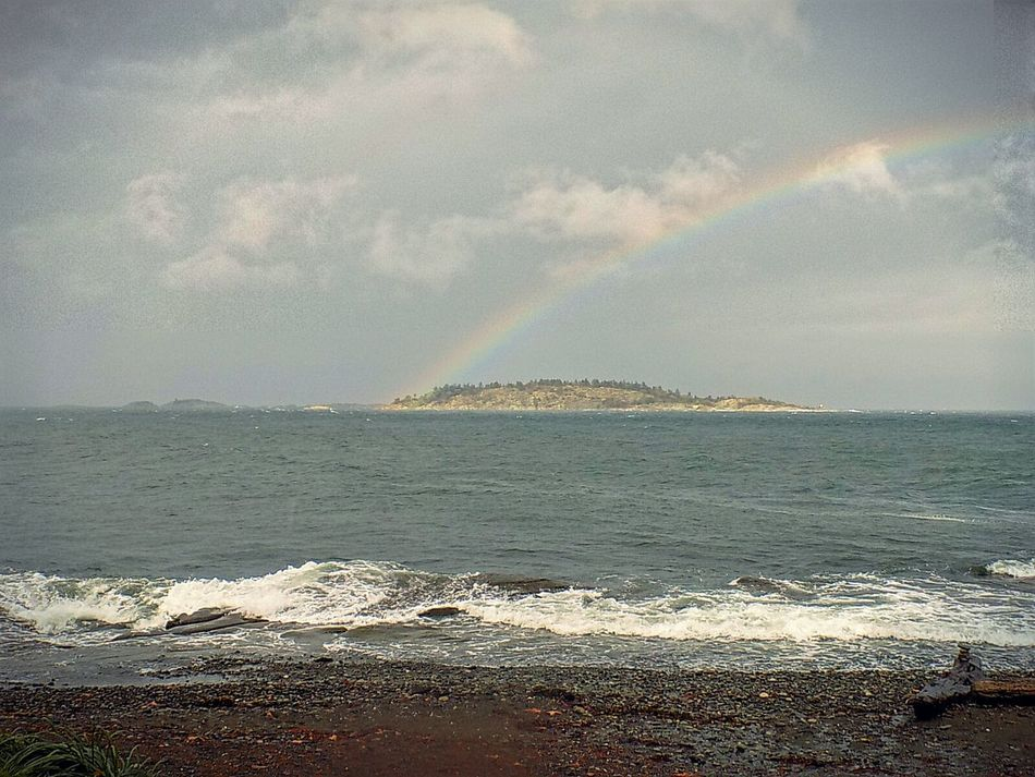 Bcstorm Rainbow Sky Sea Water Beach Scenics Tranquil Scene Wave Surf Beauty In Nature Shore Seascape Tranquility Sky Tourism Nature Vacations Travel Destinations Tide Non-urban Scene Idyllic Cloud - Sky Weather Photography