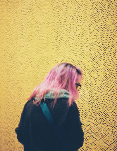 My friend Anne with her vibrant pink hair stands reading about a Kusama painting in the Hirshhorn. Taken with Canon AE-1 Program 35mm film camera. Slightly added contrast and cropped. 35mm 35mm Film Art Art Gallery Canon AE-1 Contrast EyeEm Best Shots Film Photography Filmcamera Filmisnotdead Hirshhorn  Indoors  Kusama Yayoi Lifestyles Museum One Person Photo Of The Day Pink Hair Portrait Of A Woman Real People The EyeEm Collection The Week On Eyem This Week On Eyeem Yellow Young Women Millennial Pink Paint The Town Yellow