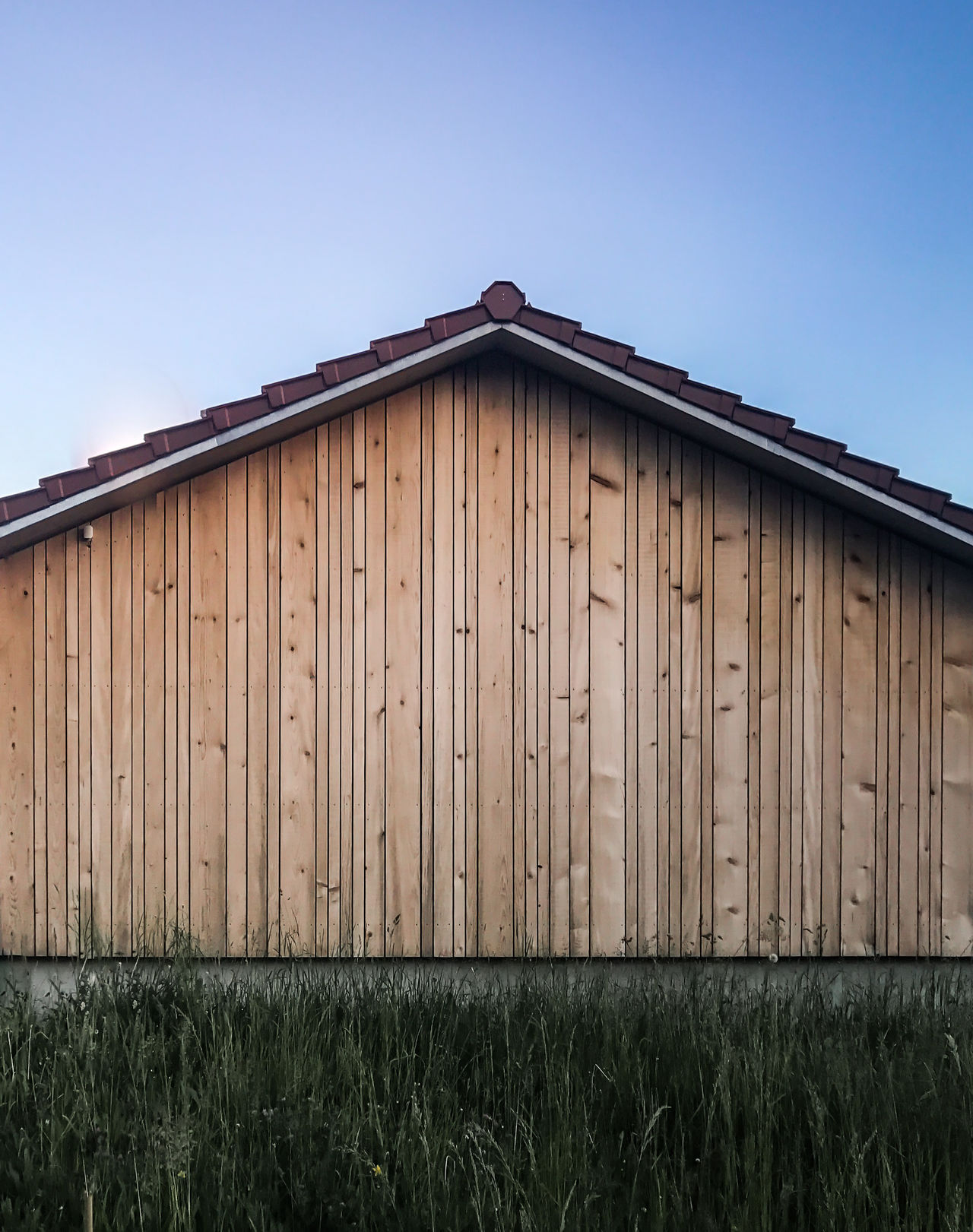 Architecture Barn Building Exterior Striped Clear Sky Country Countryside Evening Light Field Grass Stripes Pattern Hut Meadow Minimal Minimalism Minimalist Architecture Minimalobsession Nature Outdoors Pattern, Texture, Shape And Form Rural Rural Landscape Simplicity Symmetry Wood - Material