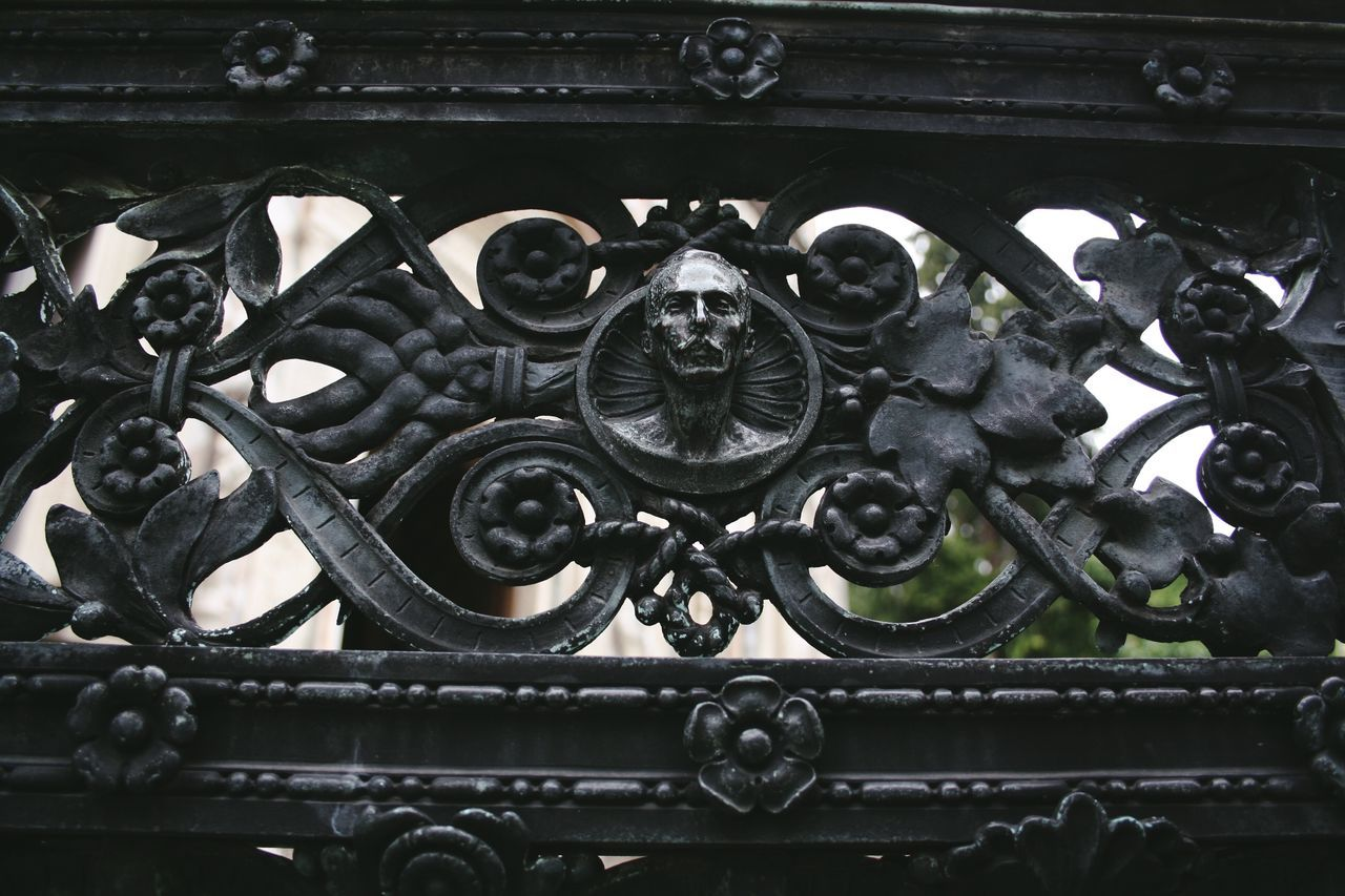Architecture Art And Craft Close-up Dark Day Fence HEAD History Low Angle View Metal No People Ornate Outdoors Parapet Pattern Railing Railling Sculpture EyeEm Selects