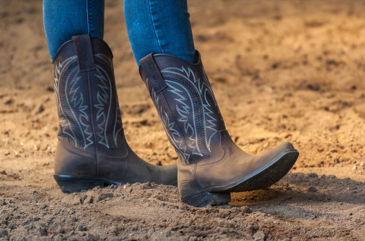 Close-up Cowboy Boots Cowboy Style Human Body Part Human Leg Jeans Low Section One Person People Real People Relaxing Relaxing Moments Sand Sandy Soil Shoe Standing Waiting Western Boots Western Riding Woman