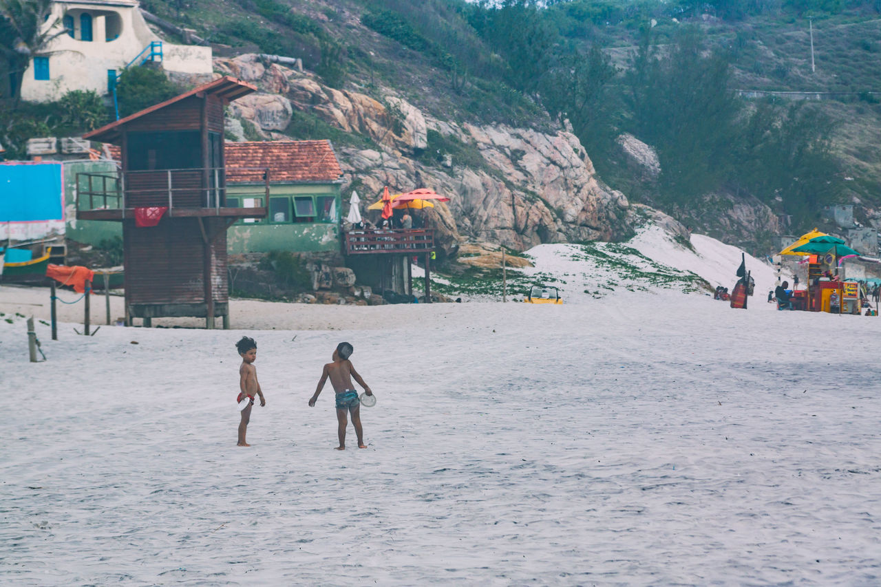 The two boys playing frisbee seem to have an argument over something. Adventure Beach Beauty In Nature Boys Building Exterior Built Structure Day Frisbee Game Kids Leisure Activity Lifestyles Men Misty Nature Outdoors People Playing Real People Sandy The Street Photographer - 2017 EyeEm Awards Togetherness Two People Vacations White
