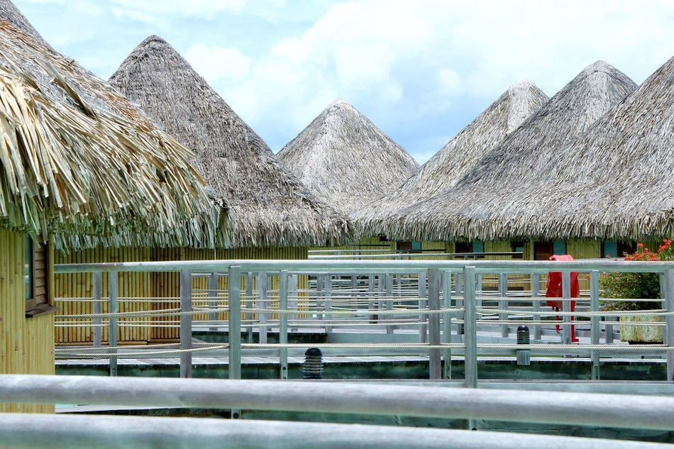 BoraBora Overwater Bungalow Overwatervilla Symmetry Tahiti Hut Sky Architecture Cloud - Sky Water Built Structure No People Day Outdoors Nature Mountain Tree