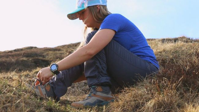 Tightening the boots for the hike down Backcountry Travel Outdoors