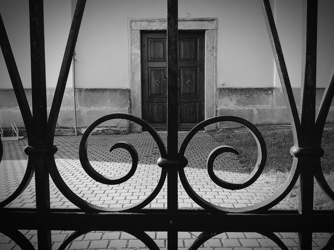 Door Doorsworldwide Wooden Door Doorway Fence Metal Fence Iron Fence Antique Vintage Doors With Stories Doors Doorwaysoftheworld Doorporn Architectural Detail Black And White Black & White Architecture_bw Black Fence Spiral Vintage Style Vintage Door Doorway To Another World Behind Bars Behind Behind The Fence