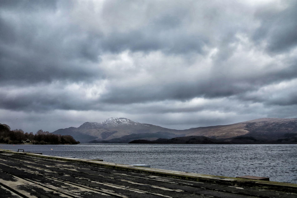http://www.head-eye-hear Beauty In Nature Cloud - Sky Day Dramatic Headeyeheart Idyllic Landscape Landscape #Nature #photography Landscape_Collection Landscape_photography LochLomond Mountain Mountain Range Nature No People Outdoors Overcast Scenics Scotland Sky Storm Cloud Tranquil Scene Tranquility Water Weather