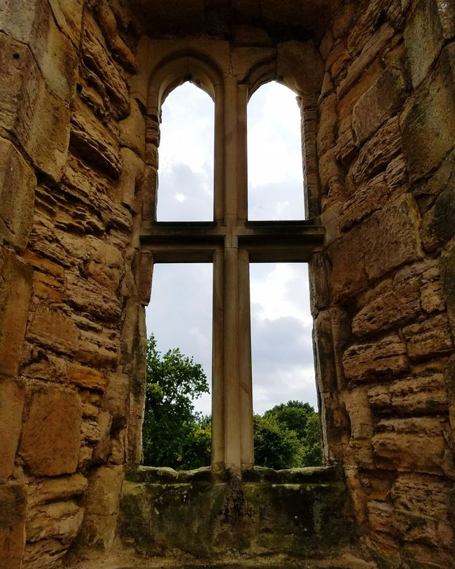 View from a castle. Castle Castle View  Castle Ruin Window Framed View Window Obsolete Abandoned Deterioration Sky Run-down Damaged Ruined Old Destruction Old Ruin Bad Condition Cloud - Sky Built Structure Architecture The Past Cloud Indoors  History House