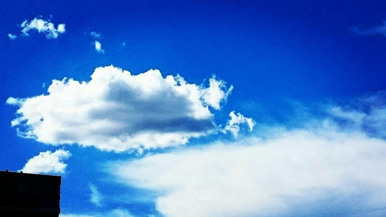 sky, low angle view, cloud - sky, blue, beauty in nature, nature, no people, day, scenics, tranquility, outdoors, sky only